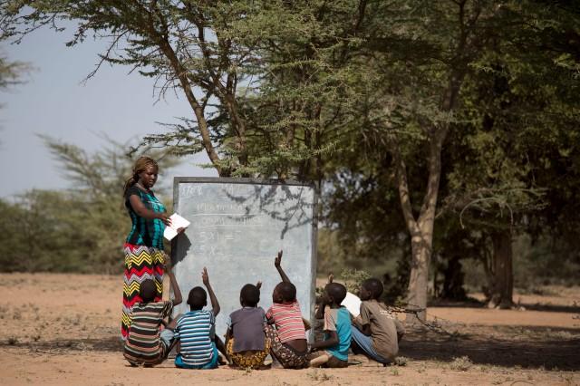 Ewesit, teaching under a tree in a mobile school in Turkana, Kenya. Photo credit:UNESCO/Karel Prinsloo